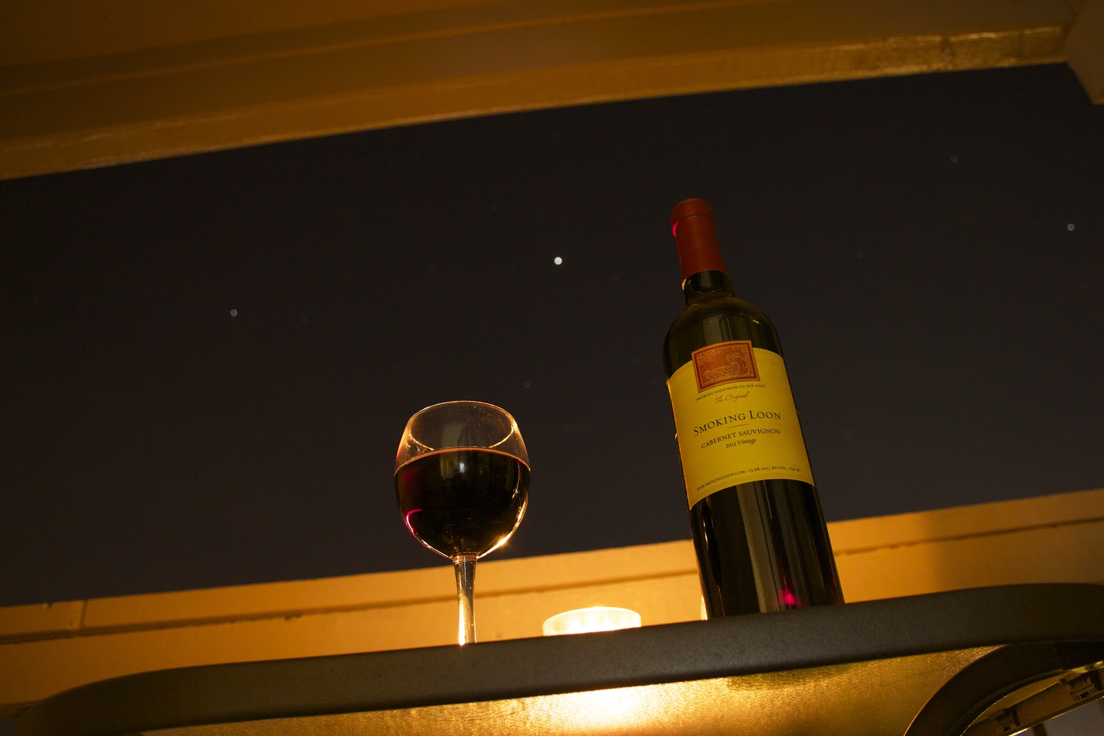 night wine glass and bottle with stars