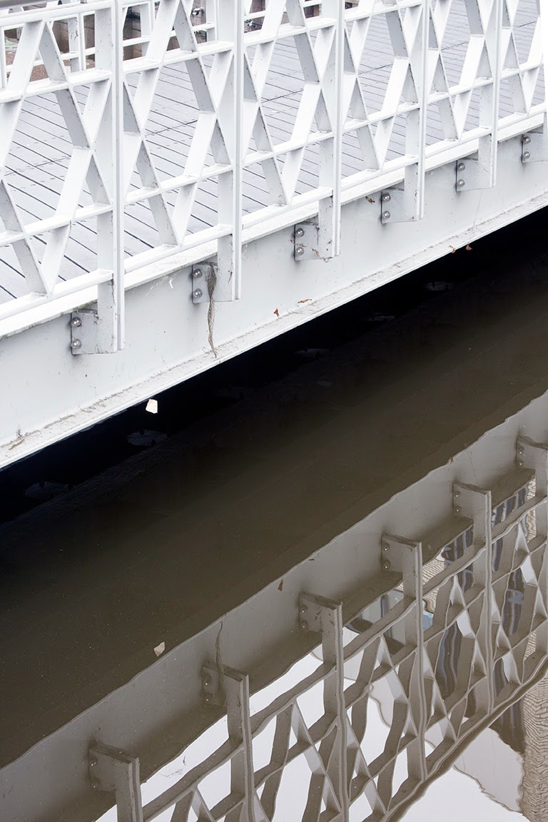 white patterned bridge and reflection