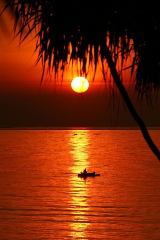 Small boat at sunset, Lombok, Indonesia