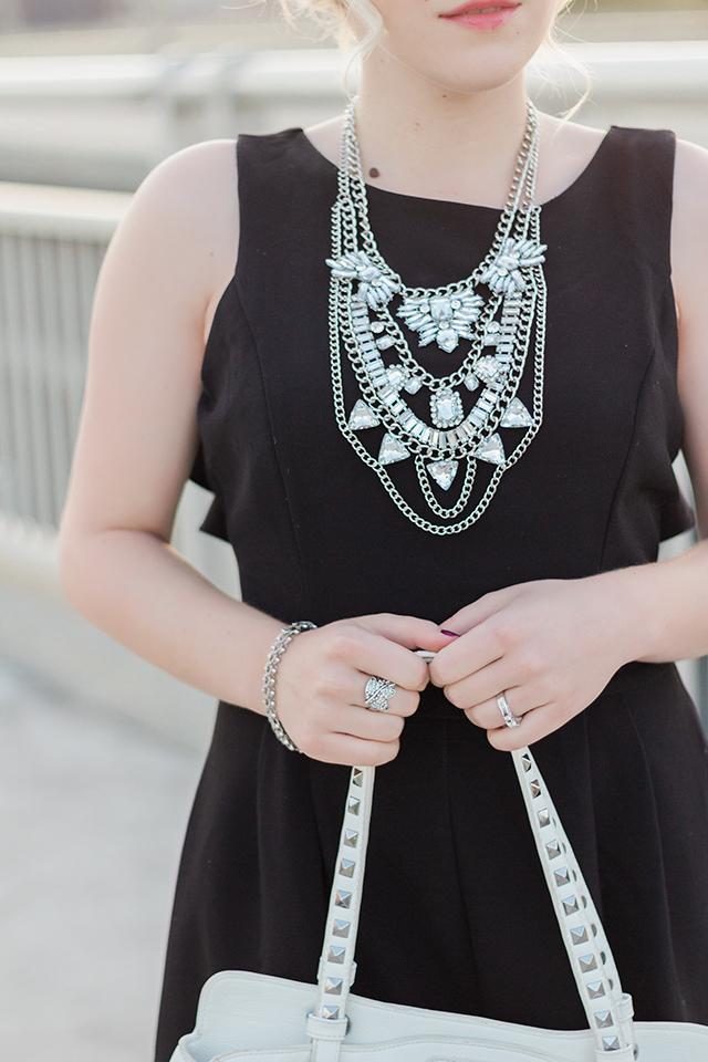 Black romper with white accessories.