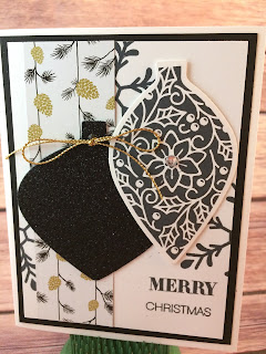 This black and gold Christmas card uses Stampin' Up!'s Delicate Ornament Thinlit Dies and the Embellished Ornaments stamp set along with the Gold Cording Trim and Winter Wonderland Designer Series Paper.  www.stampwithjennifer.blogspot.com