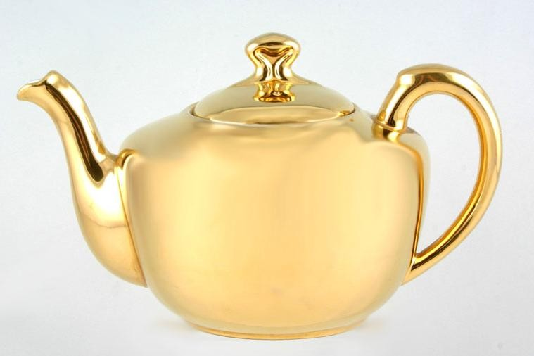 GOLD AND SILVER TEAPOTS