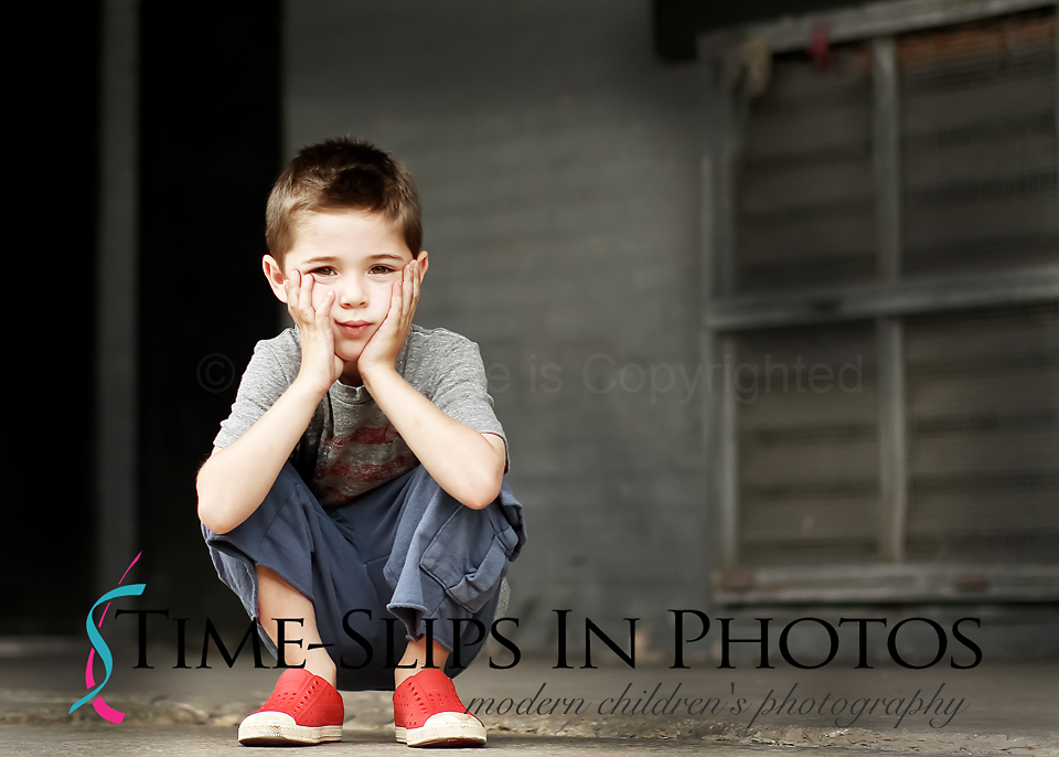 Boy_with_Red_Shoes_on_Loading_Dock