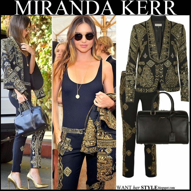 Miranda Kerr in matching black and gold embellished brocade jacket and pants by emilio pucci with bold pumps and black bag want her style october 21 2014