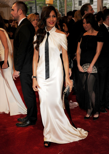 Freida Pinto in an ivory silk Chanel gown, Dana Davis Primrose black satin heels, Chopard jewels and a black clutch at the 2011 MET Gala.