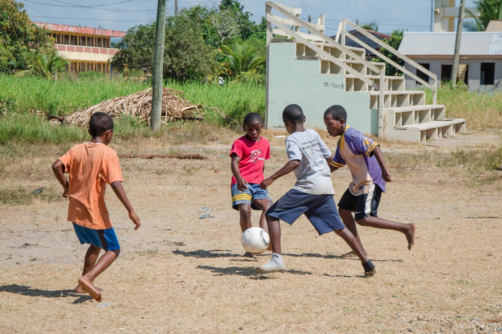 Image result for kids playing soccer in belize