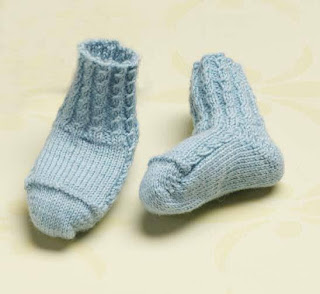 pair of blue booties along with nine other free baby bootie patterns