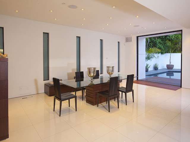Photo of modern glassy dining table in the dining room