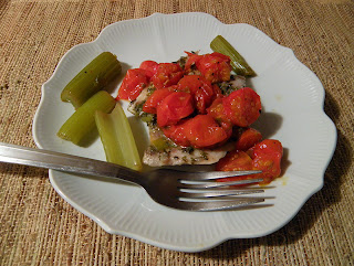Plate of Celery and Fish topped with Roasted Tomatoes