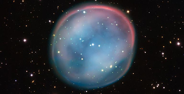 This extraordinary bubble, glowing like the ghost of a star in the haunting darkness of space, may appear supernatural and mysterious, but it is a familiar astronomical object: a planetary nebula, the remnants of a dying star. This is the best view of the little-known object ESO 378-1 yet obtained and was captured by ESO's Very Large Telescope in northern Chile. Credit: ESO