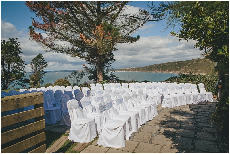 Chairs set for an outdoor ceremony by the sea