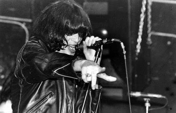Joey Ramone singing in a leather jacket