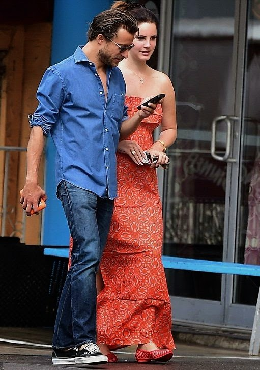 Lana Del Rey taking it to the Red Maxi Dress as she walks with boyfriend at New York