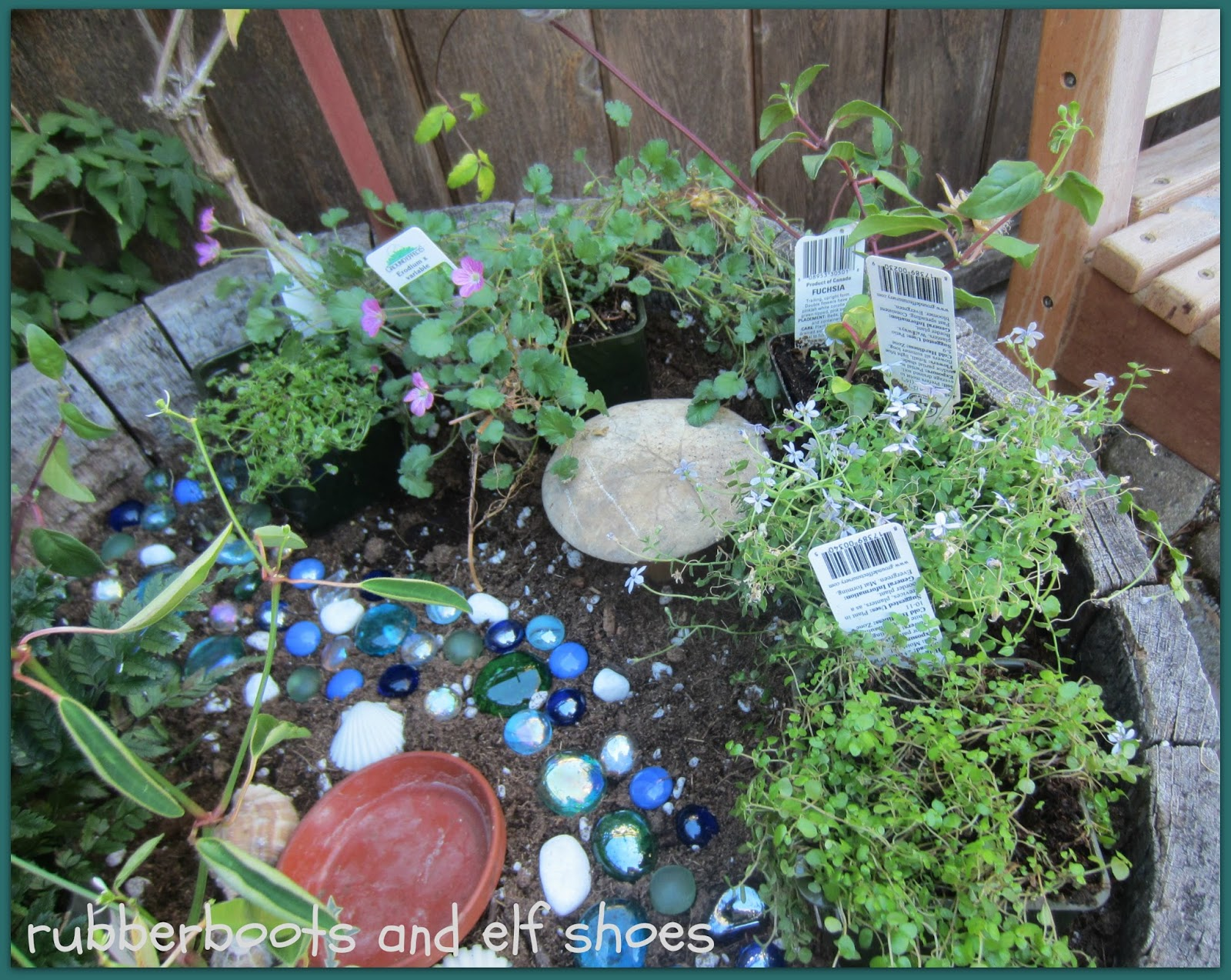 A fairy garden for the garden fairies rubber boots and Fairy garden plants