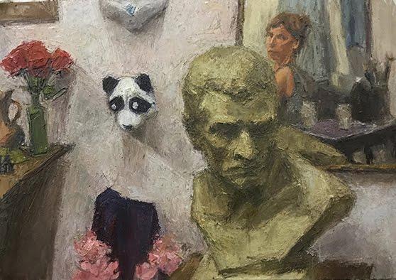 Auto con escultura y oso