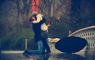 couple kissing in rain