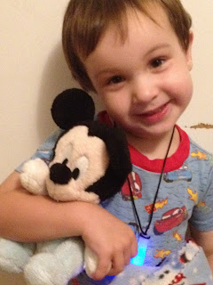 Toddler and Disney plush doll.  Disney is developing product footprint baselines for plush dolls.