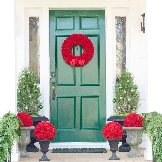 ... Of The Front Door. Arrange A Simple Garland Decorated With Pinecones  Around The Door Frame, And Complete The Scene With Two Miniature Christmas  Trees In ...