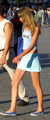 Girl in tight blue skirt on the street