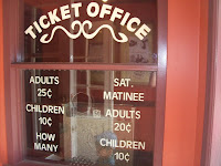 Old-fashioned ticket office with displayed prices