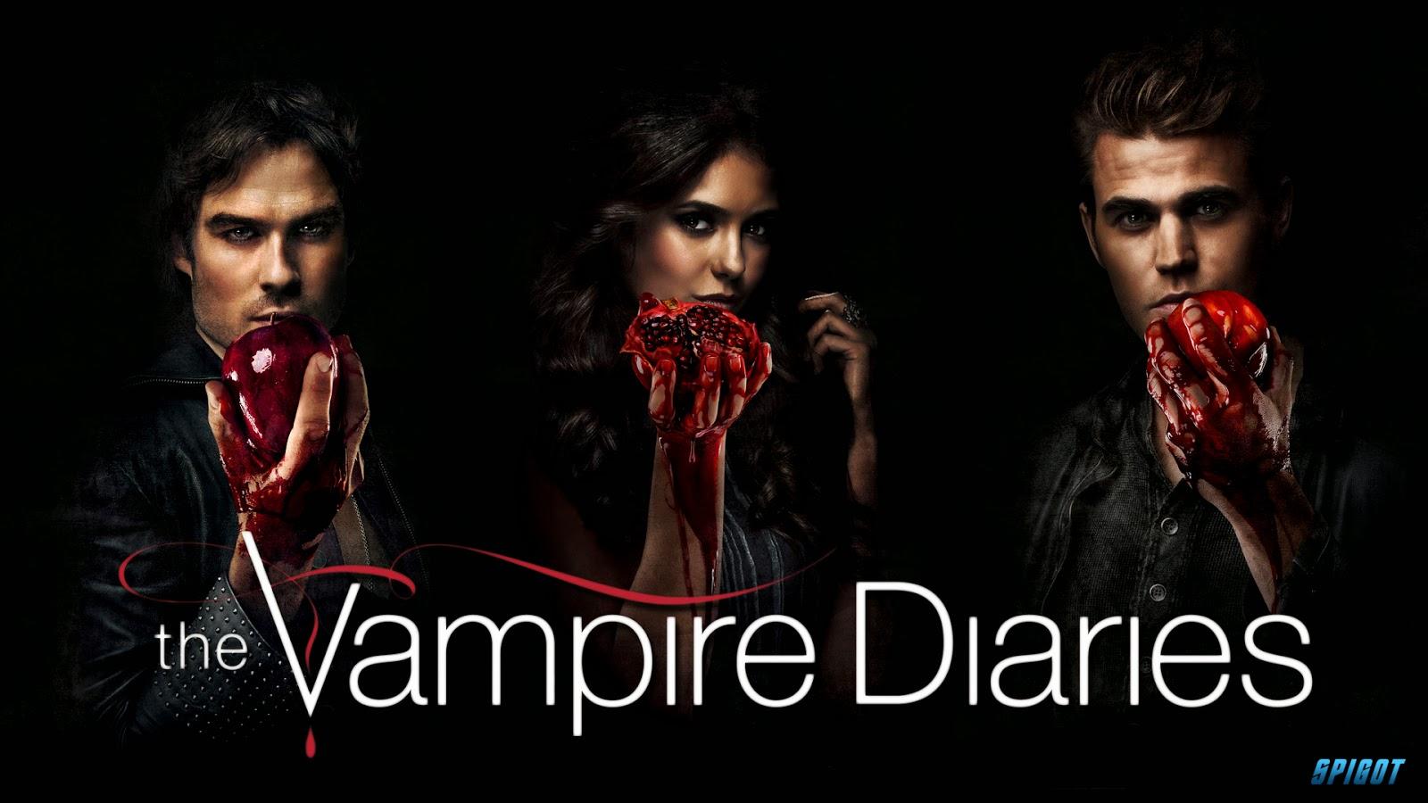 A imagem apresenta os personagens principais Damon,Stefan e Elena da série The Vampire Diaries.Eles estão segurando corações nas mãos.