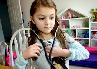 Tessa listened to her heart and then mine. She got a kick out of how much faster hers beats. (I bought an inexpensive Omron Sprague Rappaport Stethoscope from Amazon for this activity. It worked perfectly for us.)