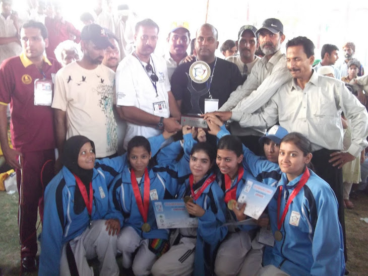 Coach Kamran Kureshi with female team rcving 1st position trophy in Sindh games 2011.