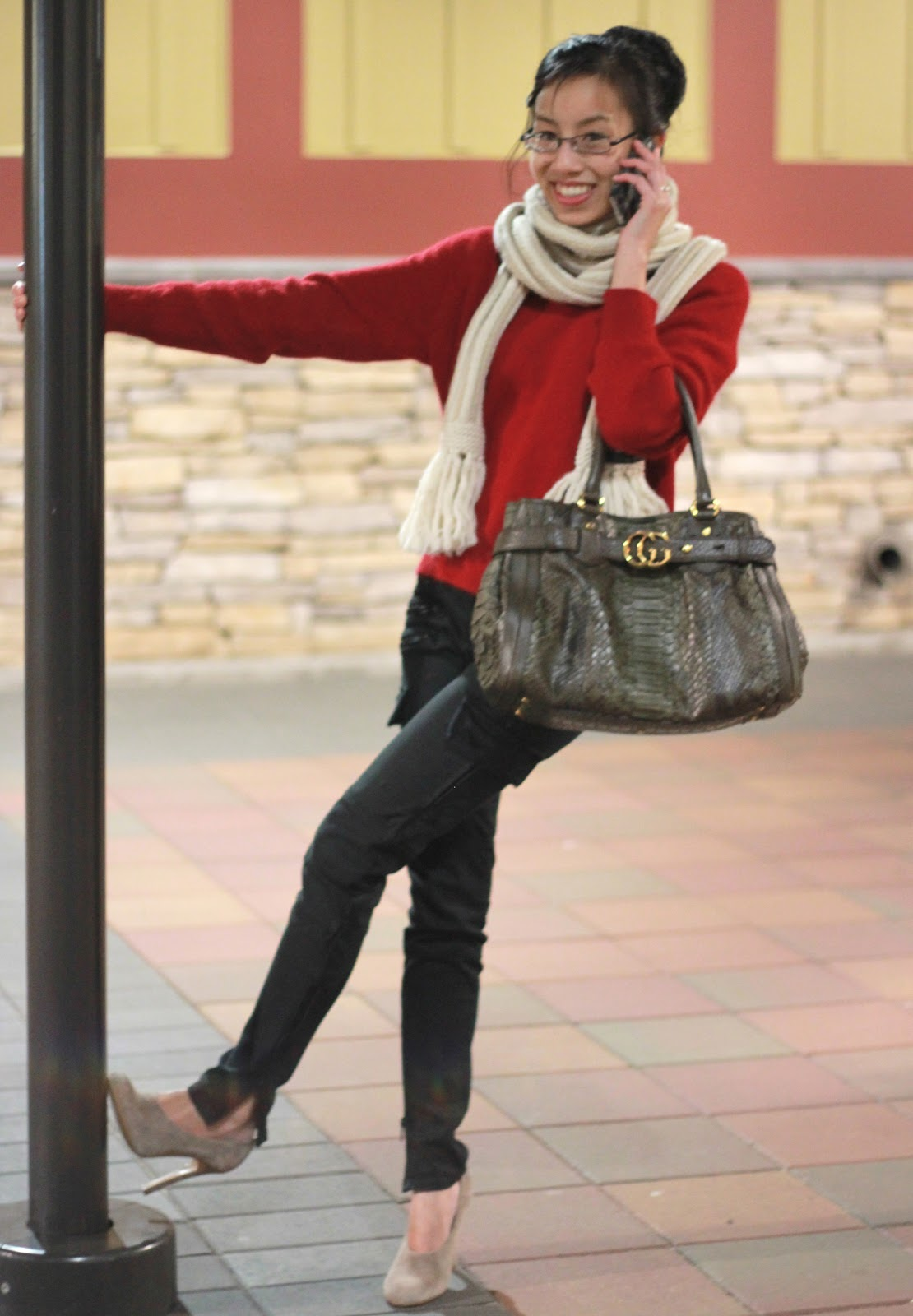 red sweater and olive pants outfit trend winter