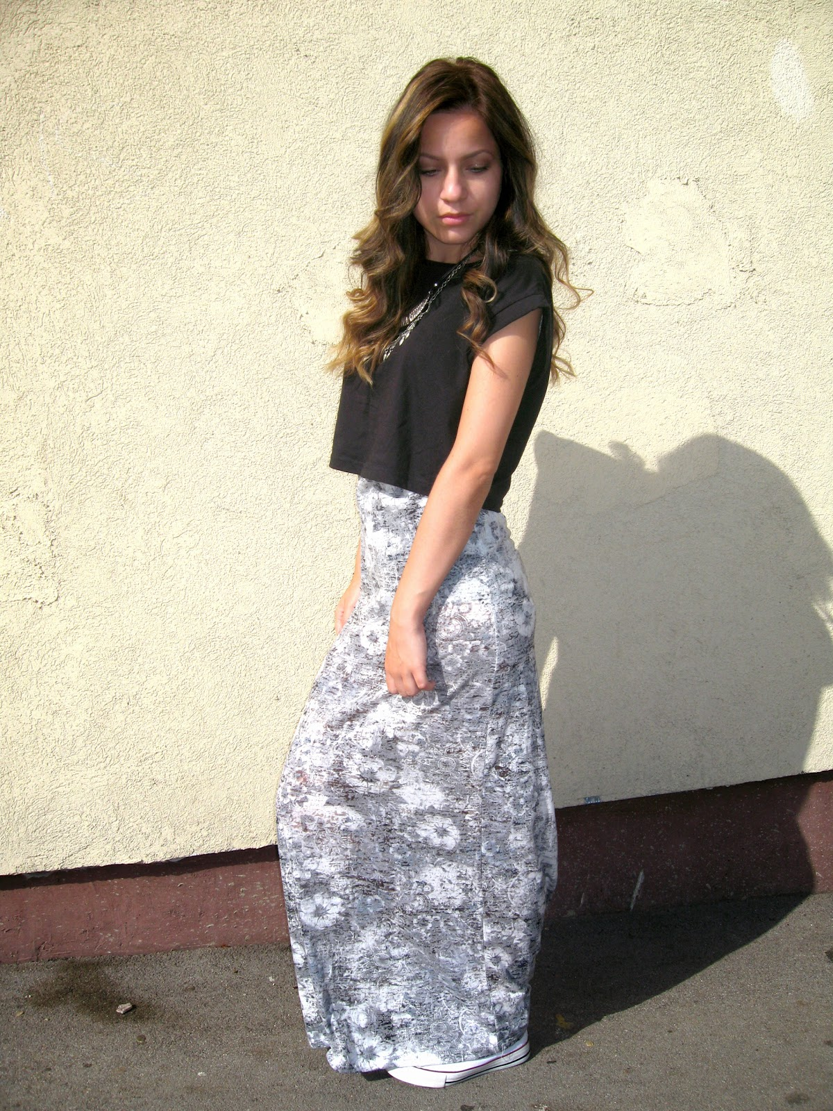 outfit, grey maxi dress with subtle white flowers, white converse, black crop top, soft curls, statement necklace, layered gold silver necklaces