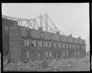 Chickens grazing in front of worker's row-houses at the Point, 1917, Pittsburgh