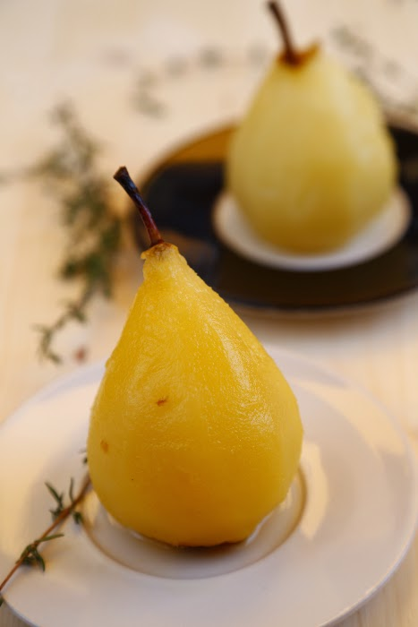 Pears on small plates and thyme sprigs