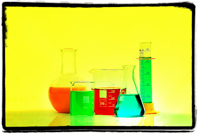 Liquids in chemistry flasks and beakers