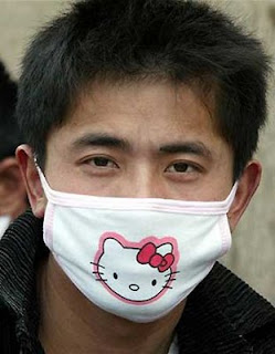 Asian guy wearing weird Hello Kitty face mask