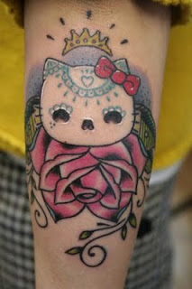 Hello Kitty creepy eyes mask weird tattoo
