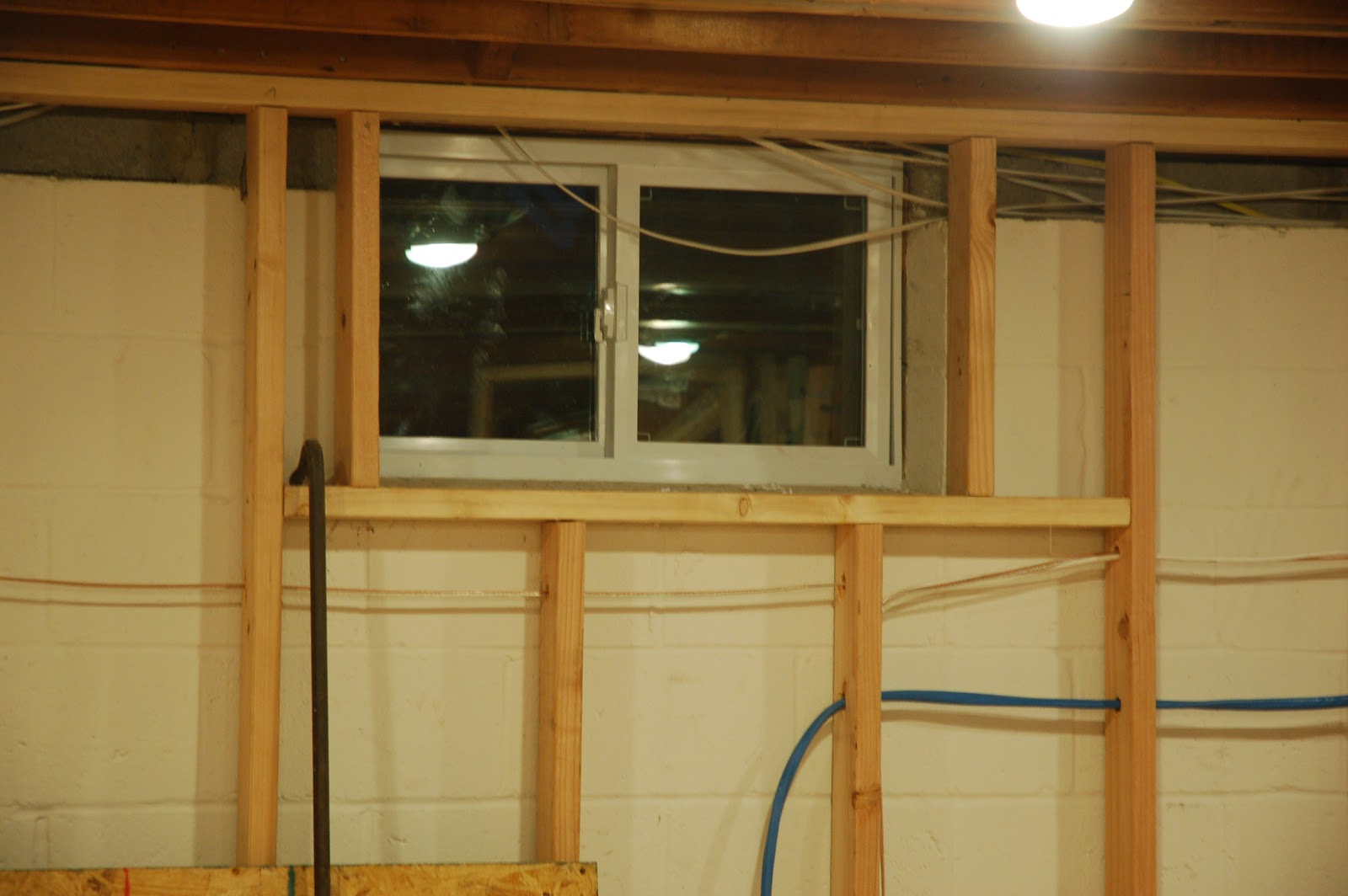 Window frames framing basement windows Walkout basement windows