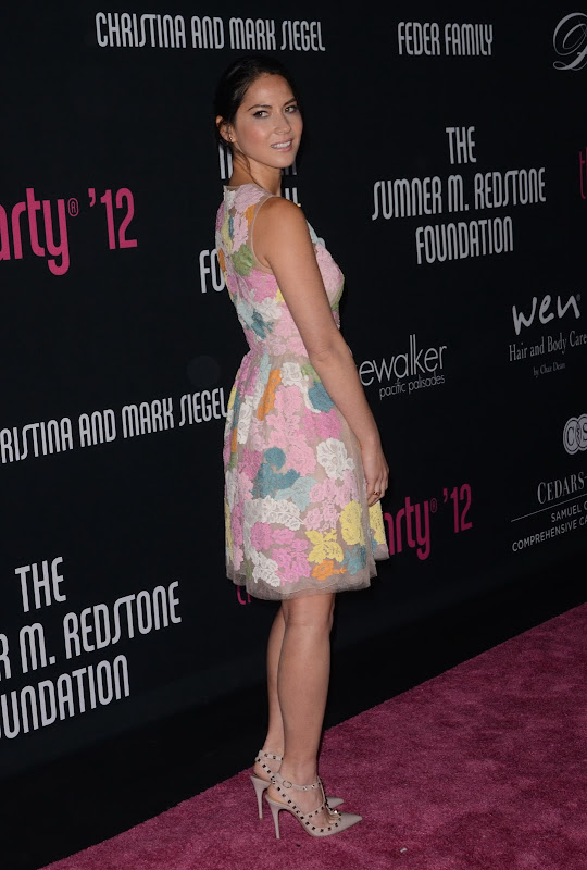 Olivia Munn at 8th Annual Pink Party red racpet
