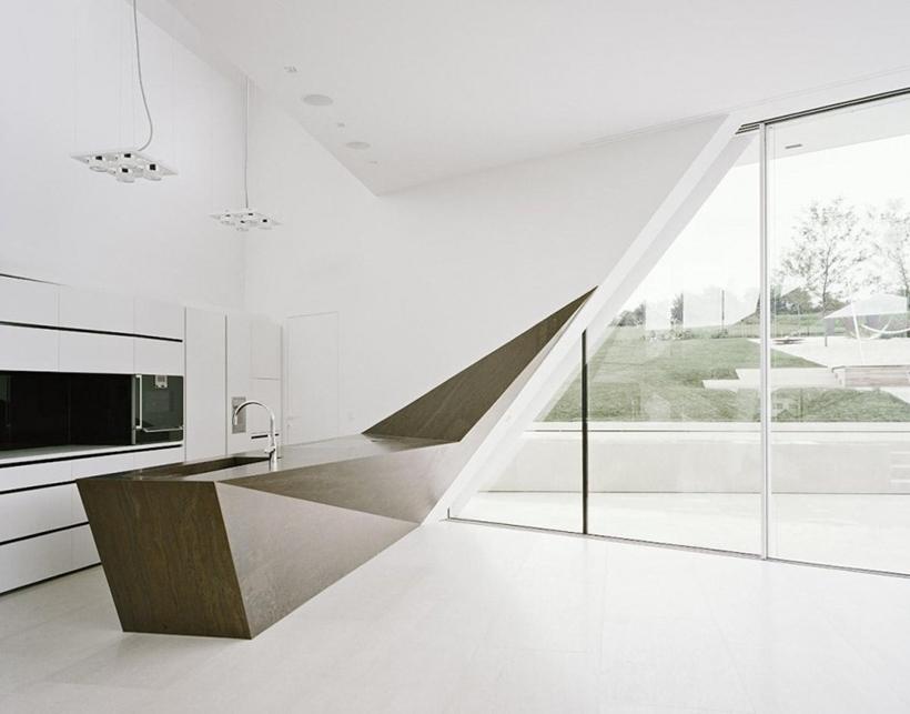 Futuristic kitchen in Villa Freundorf by Project A01 Architects