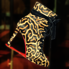 Christian Louboutin Eloise red sole bootie in leopard print pony calfskin.