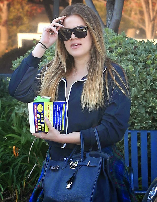 Khloe Kardashian reads about fat burning