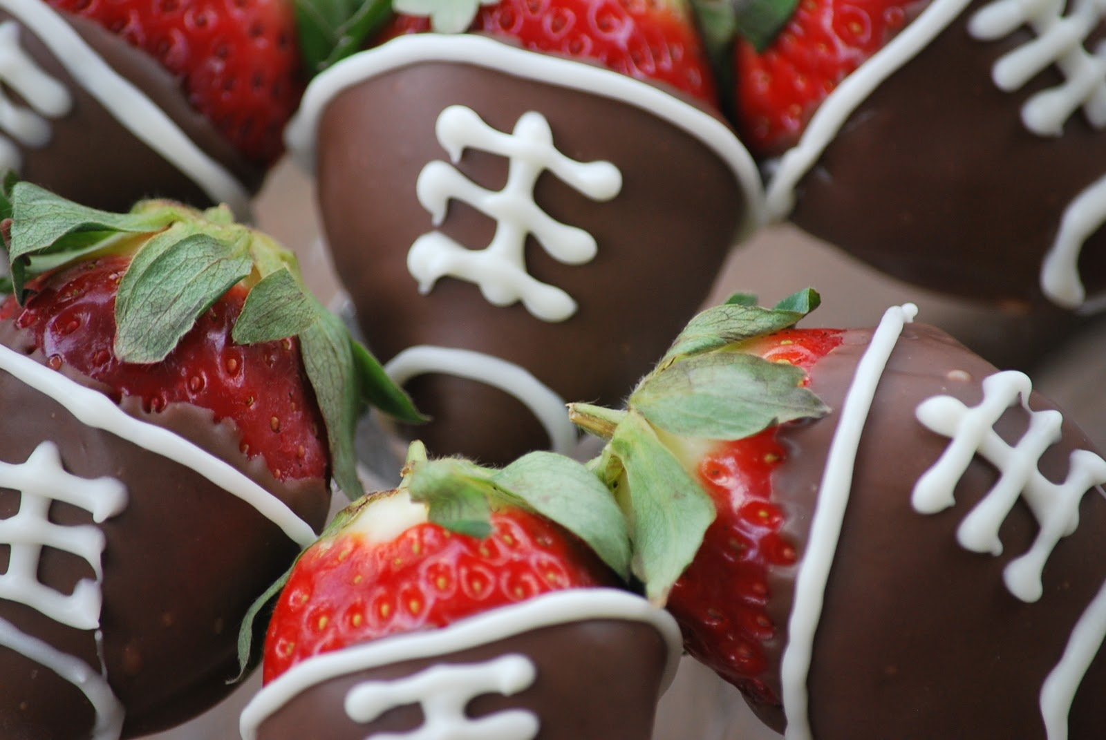 chocolate covered strawberry footballs to eat during the big game