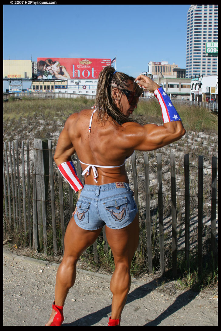 Betty Viana - Adkins Flexing Her Bicep And Muscular Calves