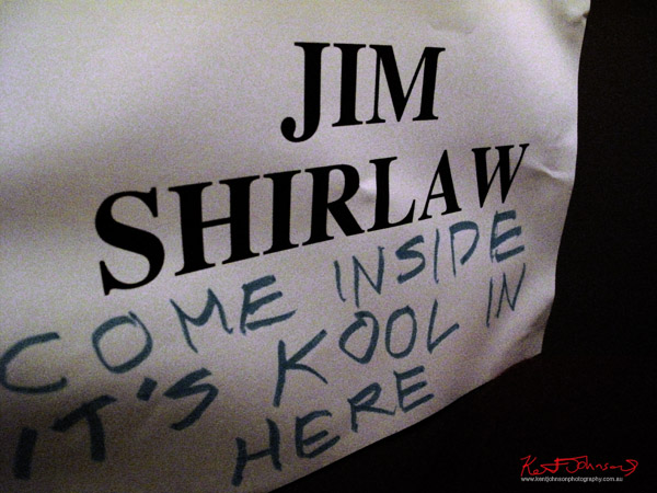 Jim Shirlaw art performance, poster on door, 700 Photos