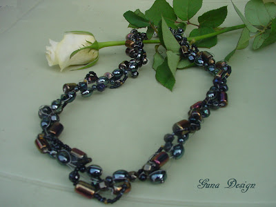 Handmade beaded necklace from black glass beads made by Gunadesign
