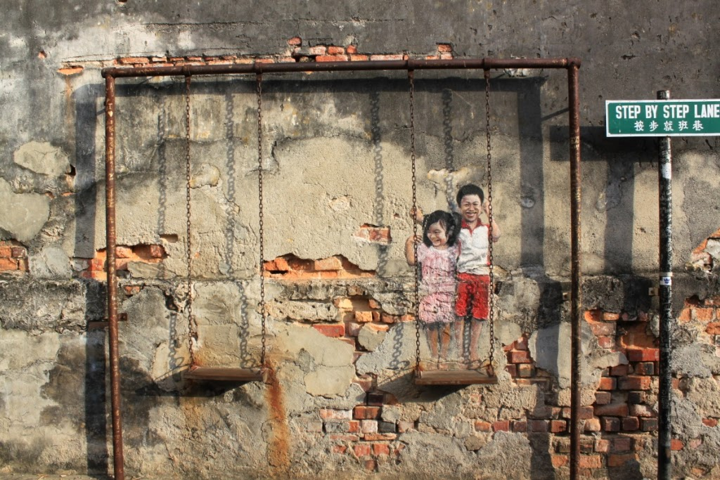 Penang street art - Children on the swing - Ernest Zacharevic