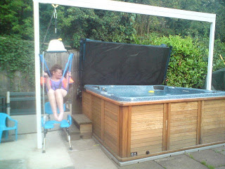 Bespoke gantry system for disabled access to hot tubs.
