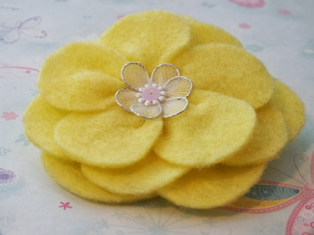 http://folksy.com/items/4199862-Brooch-yellow-felt-flower