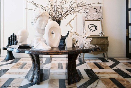 The peak of tr s chic a focal in the foyer for Kelly w interior designer