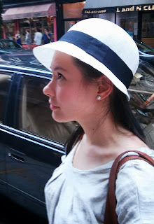Lovely young lady in Linen summer cloche hat from The Hat House NYC