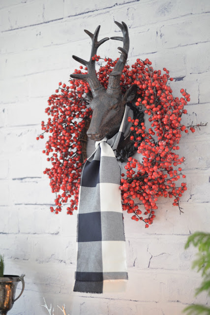 whitewashed brick wallpaper | reindeer head with berry wreath and plaid scarf | Ramblingrenovators.ca