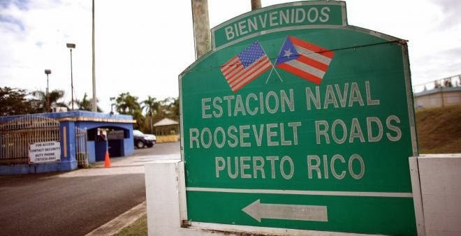 In this photo taken on Jan. 25, 2012, a welcome sign stands at the entrance of the former Naval Station Roosevelt Roads in Ceiba, Puerto Rico. (AP Photo/Ricardo Arduengo)